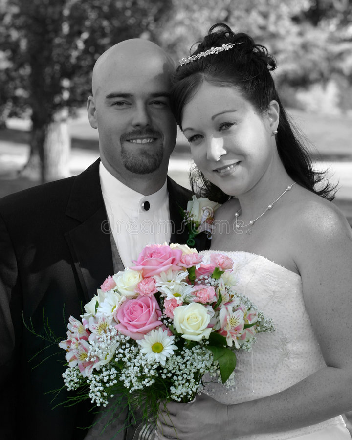 Wedding Bride and Groom. Bride and groom just before the wedding. Black and white with only the flowers in color. If you like this photo, please see my portfolio royalty free stock photos