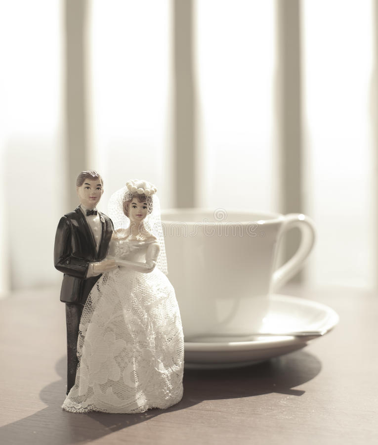 Wedding bride and groom couple doll with coffee cu