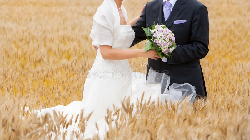 Bride and groom in the garden stock photography