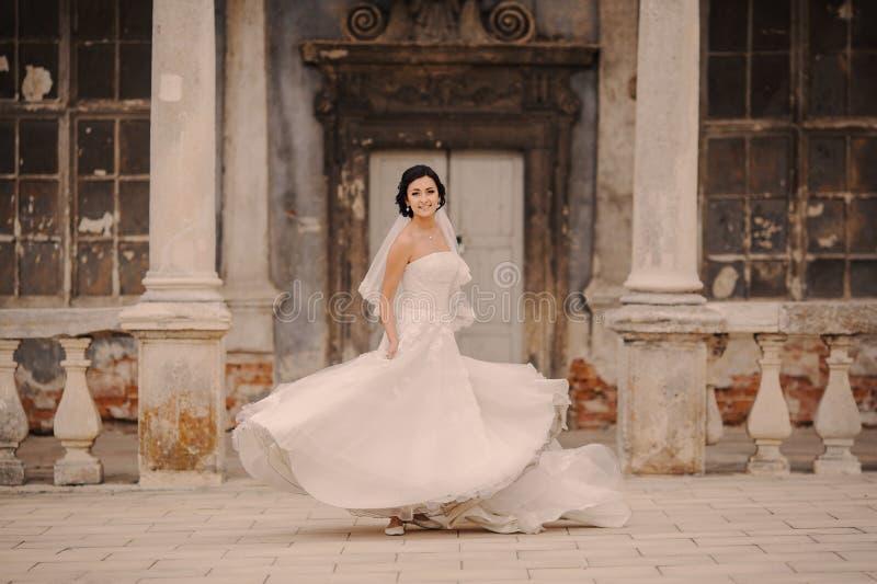 Wedding bride near the castle architecture stock photo