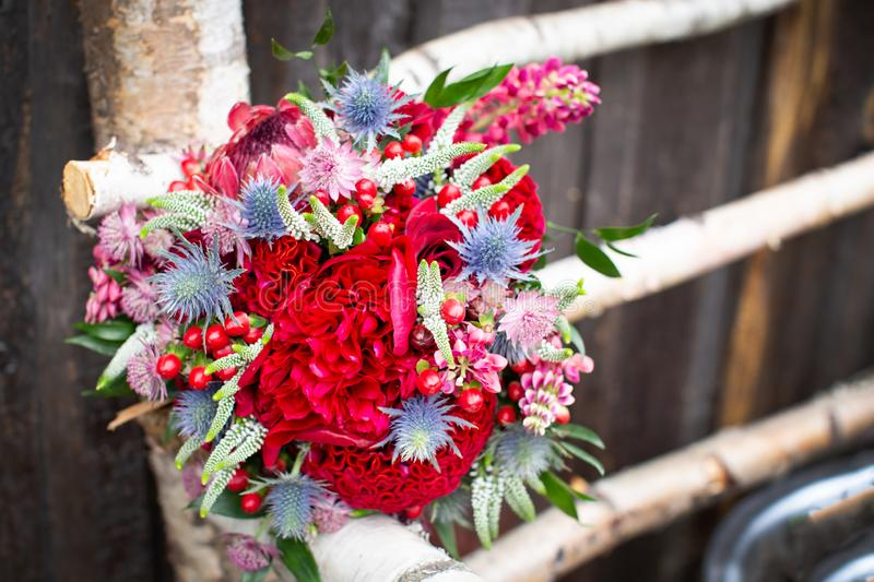 Wedding. The bride`s bouquet. Wedding bouquet rustic style with red peonies royalty free stock photography