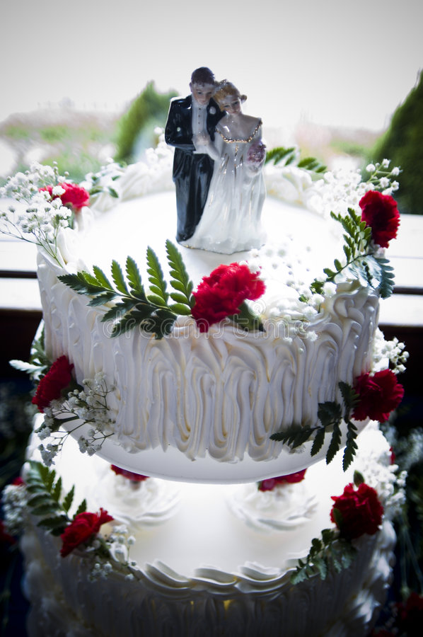 Wedding cake. With a bride & groom statue on top stock photos