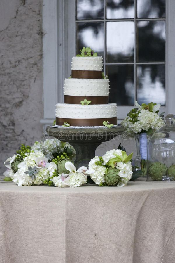 Wedding cake. On stand with decorations royalty free stock photos