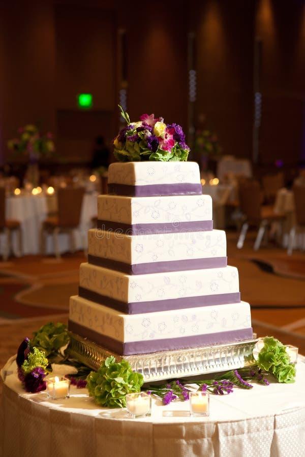 Wedding cake. White and purple wedding cake stock image