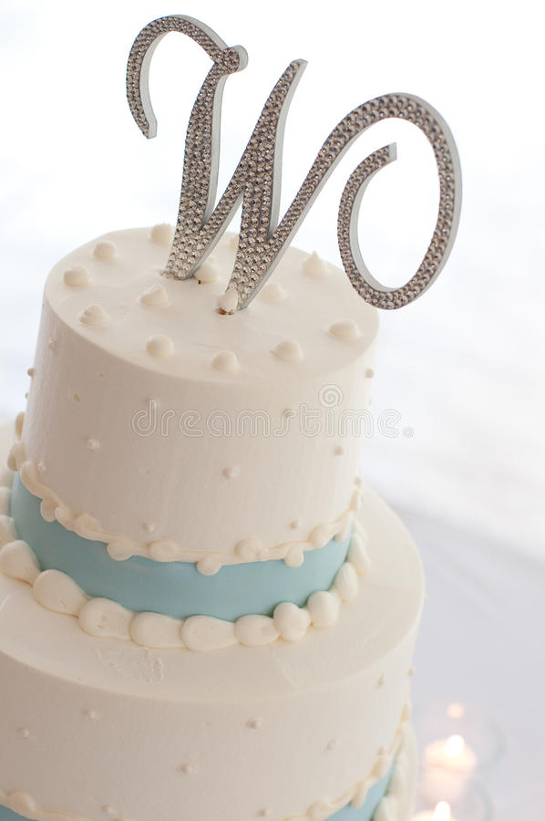 Wedding cake. White and blue wedding cake royalty free stock photo