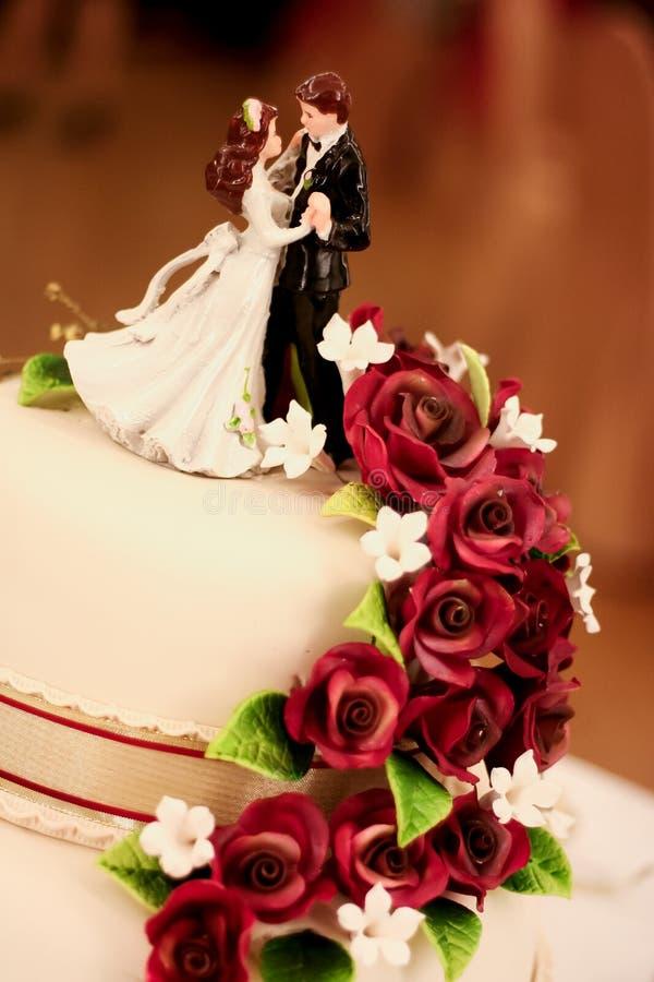 Wedding Cake 2. Bride & groom figures on a wedding cake stock images