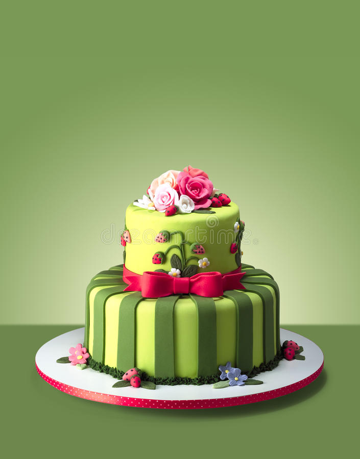 Wedding cake. Green wedding cake on a green background stock photography