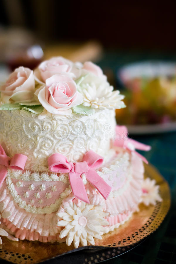 Wedding cake. With figures of rose stock image