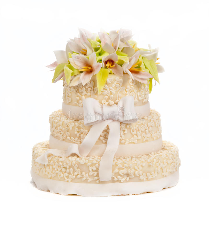 Wedding cake. With flowers & bow royalty free stock photography