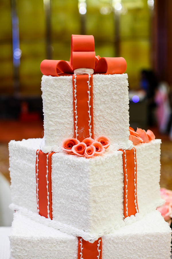 Wedding cake. With pink flowers and ribbons royalty free stock image