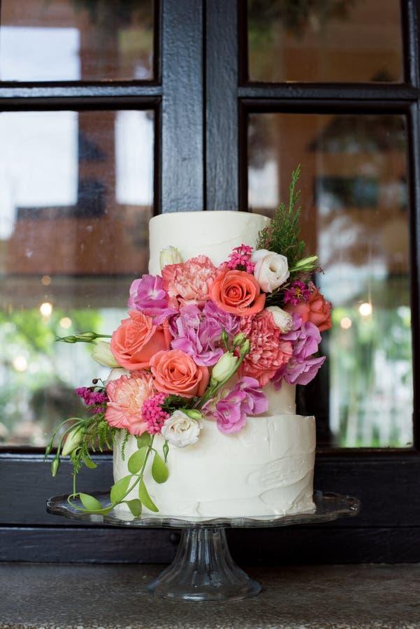 Wedding cake. Beautiful wedding cake with flower royalty free stock photos