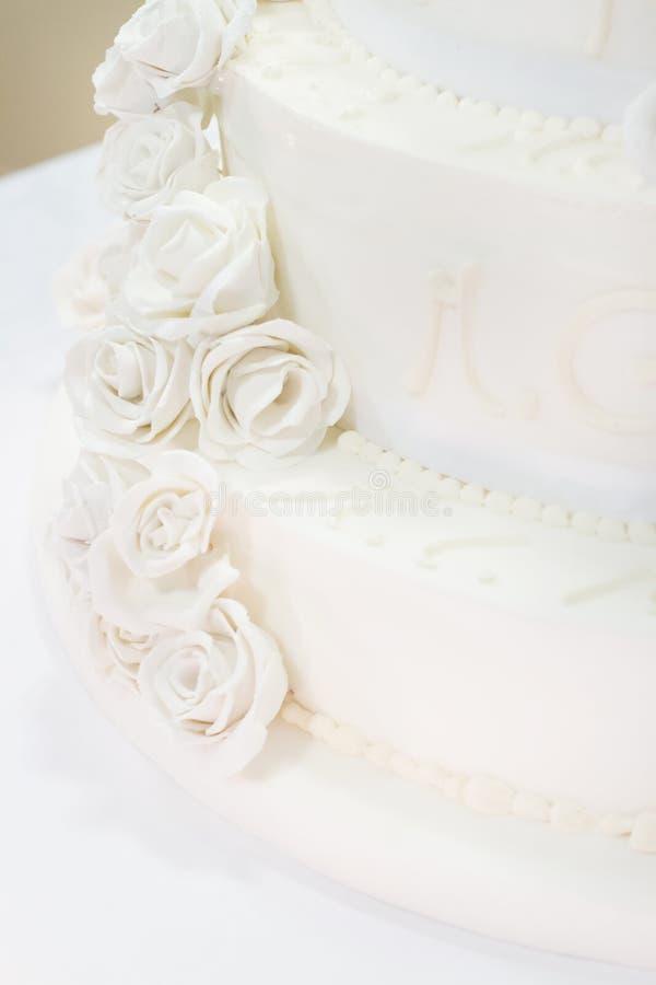 Wedding cake with roses royalty free stock image