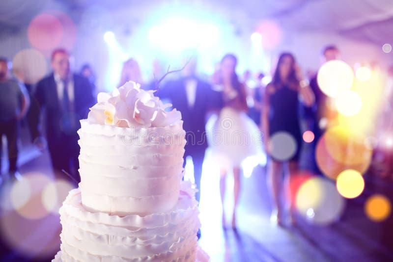 Wedding cake. A big wedding cake with white roses on it royalty free stock photos