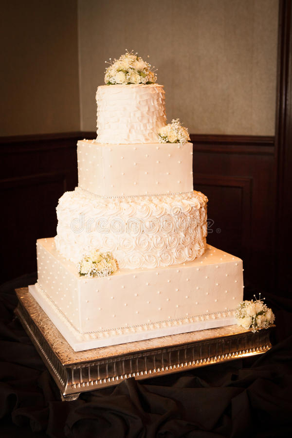 Wedding Cake Bliss. Beautiful shot of wedding cake covered in buttercream and fondant icing stock photos