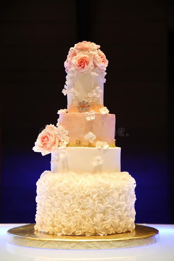 Wedding cake. And bouquets on table royalty free stock image