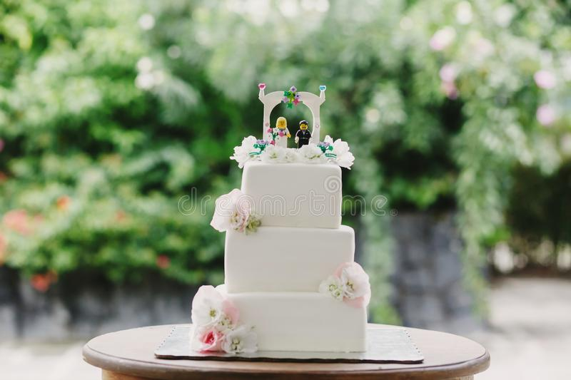 Wedding cake with bride and groom in lego toys royalty free stock photo