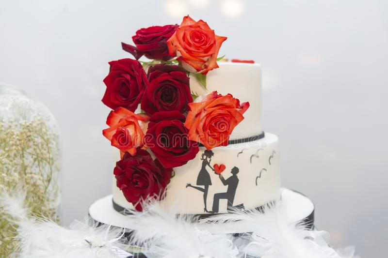 Wedding cake on the bride`s desk royalty free stock photography