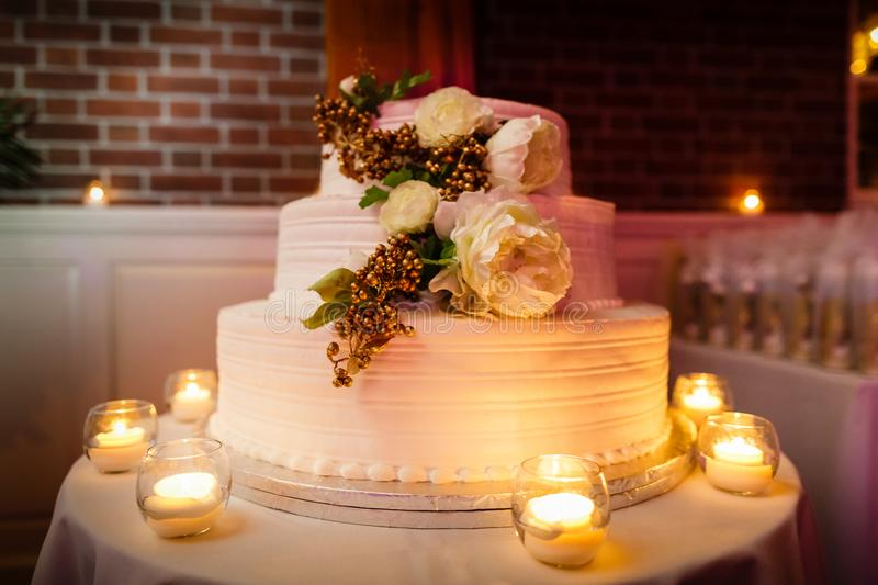 Wedding cake with candles at reception stock photos