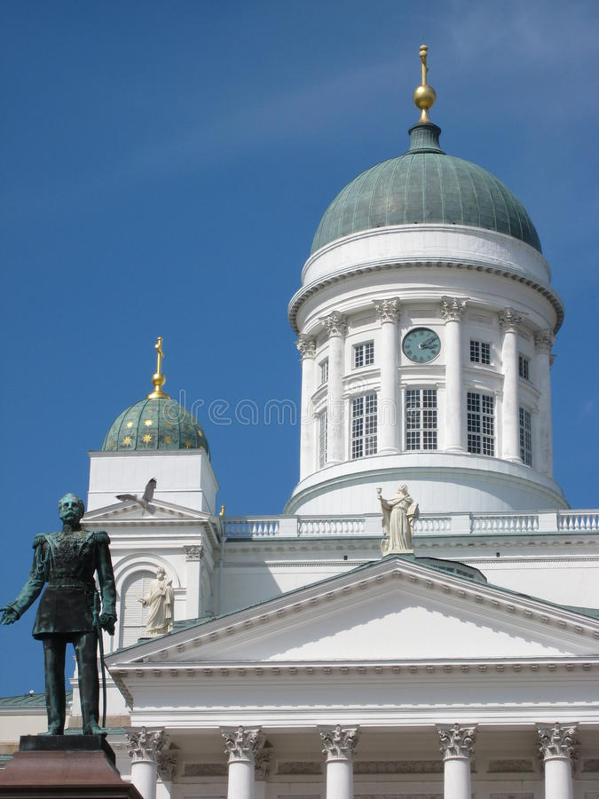 Wedding Cake Cathedral and Emperor Alexander II statue in Senate Square, Helsinki stock photo