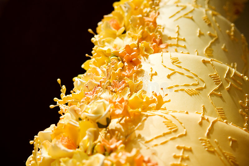 Wedding Cake Closeup. Closup / Macro photo of a peach colored Wedding Cake with Cream flowers royalty free stock images
