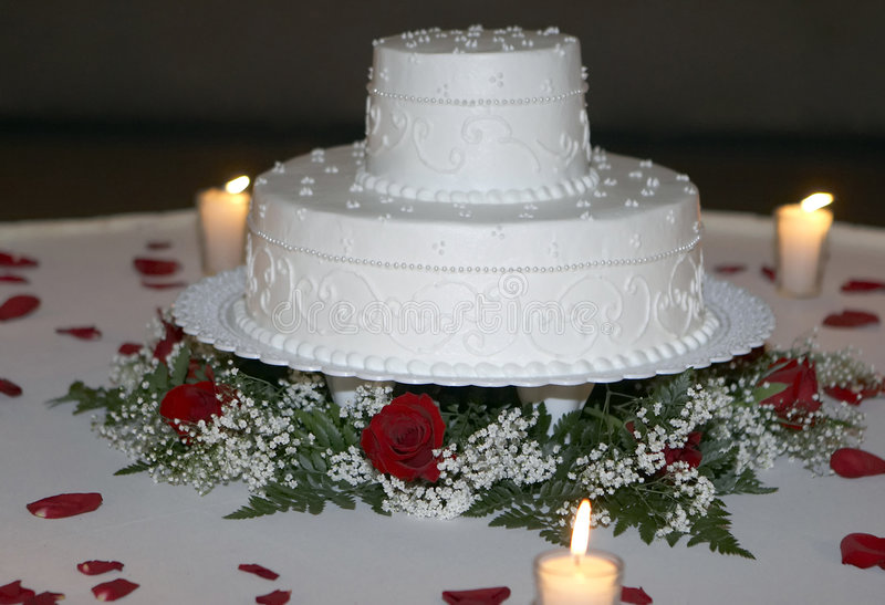 Wedding Cake Closeup by Candlelight royalty free stock image