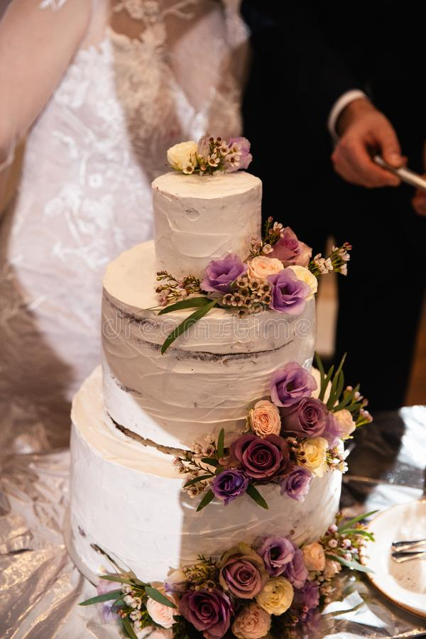 Wedding cake closeup at a real reception and the end of the party - Closeup royalty free stock photography