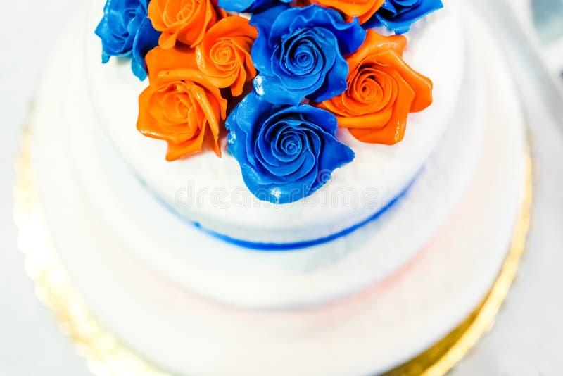 Wedding cake covered mastic with decorative roses close up stock photo