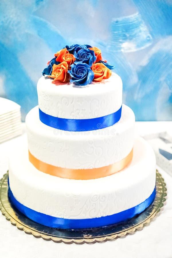 Wedding cake covered mastic with decorative roses stock photos