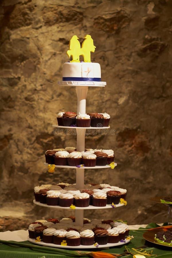 Wedding cake with cupcakes royalty free stock photo