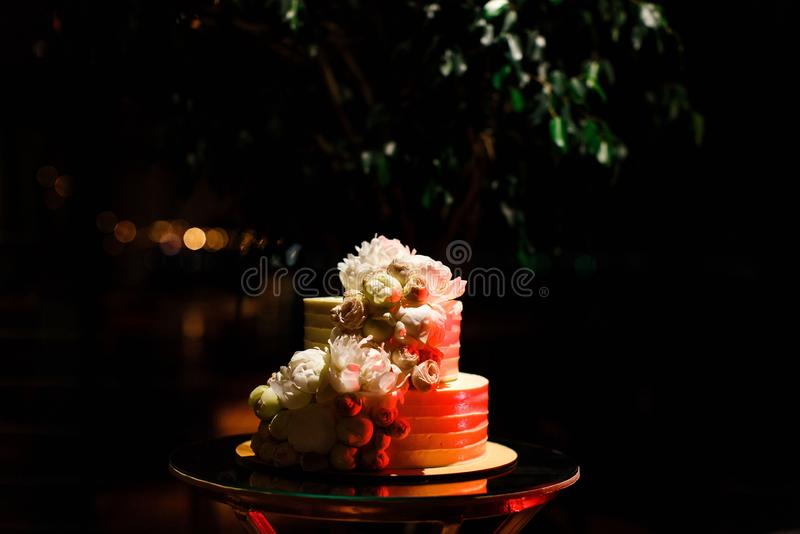 Wedding cake lighted with red color royalty free stock images