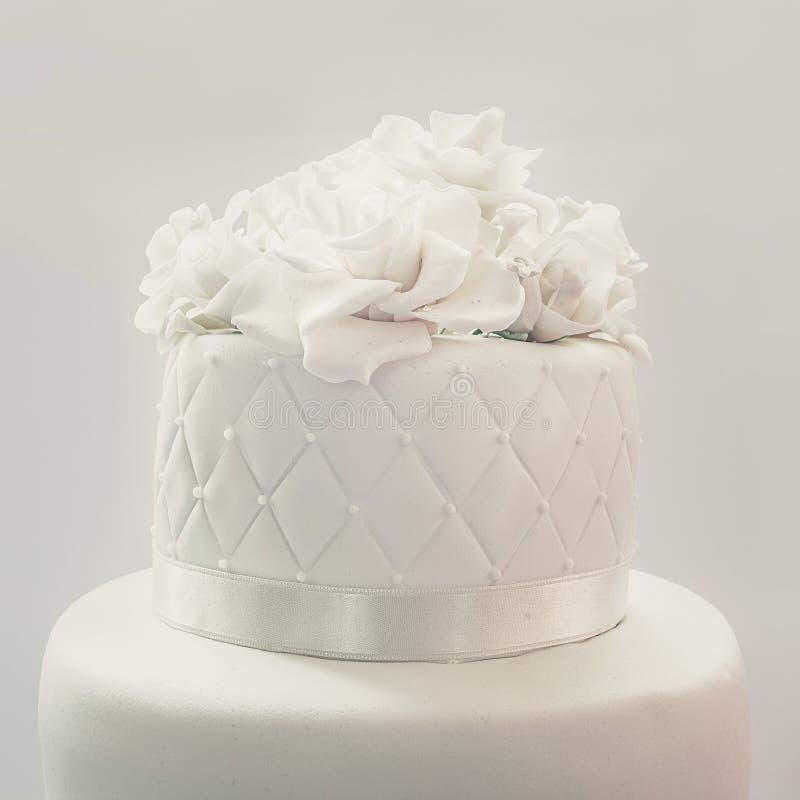 Wedding Cake Decoration. Details of a wedding cake, decoration with white fondant on gray background stock photography