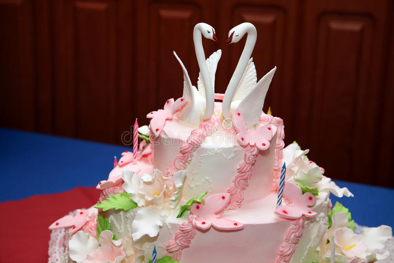 Wedding cake with decorative swans closeup stock photography