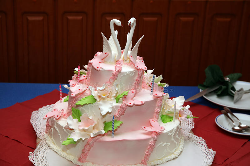 Wedding cake with decorative swans closeup royalty free stock images