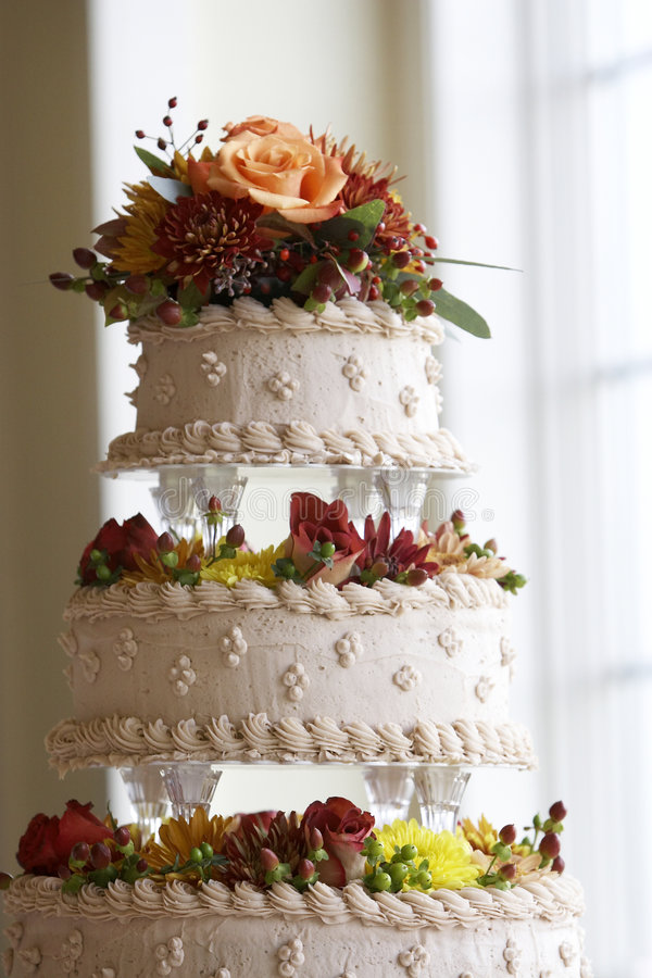 Wedding cake with flower decorations stock image