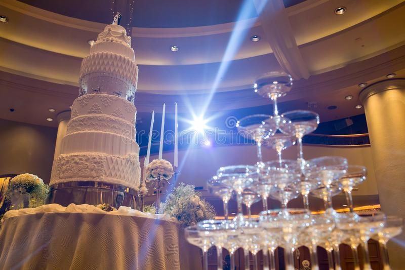 wedding cake on flower near Champagne glass pyramid. stock photography