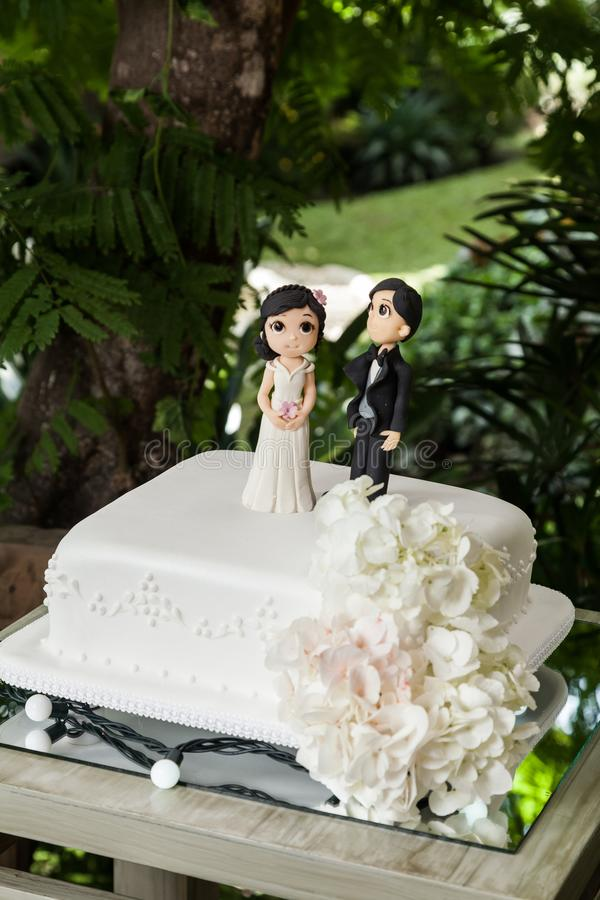 Wedding cake with grooms figure on the cake royalty free stock image