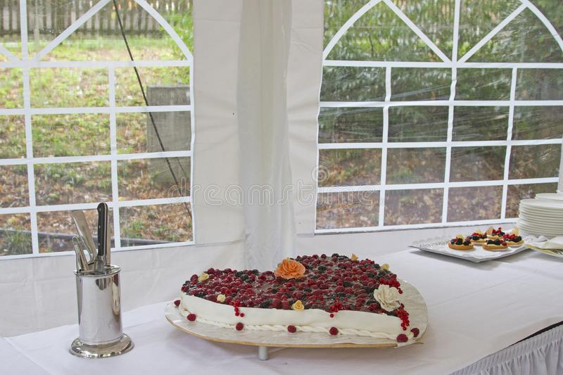 Traditional Wedding Cake Topped With Berry Fruits Stock Photo