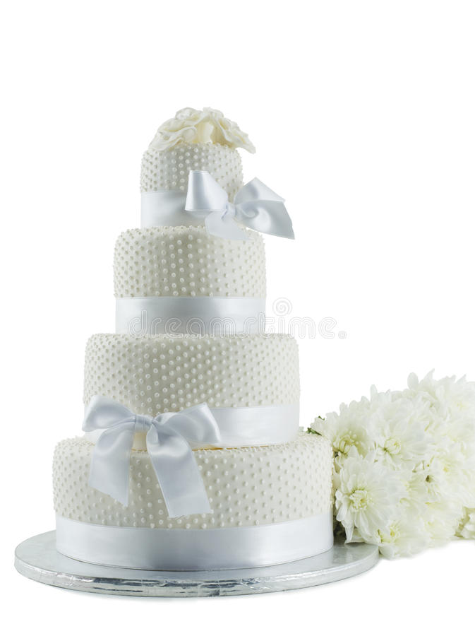 Wedding Cake Isolated On White Background. Wedding Cake With Bunch Of Flowers Isolated On White Background With Clipping Path stock photography