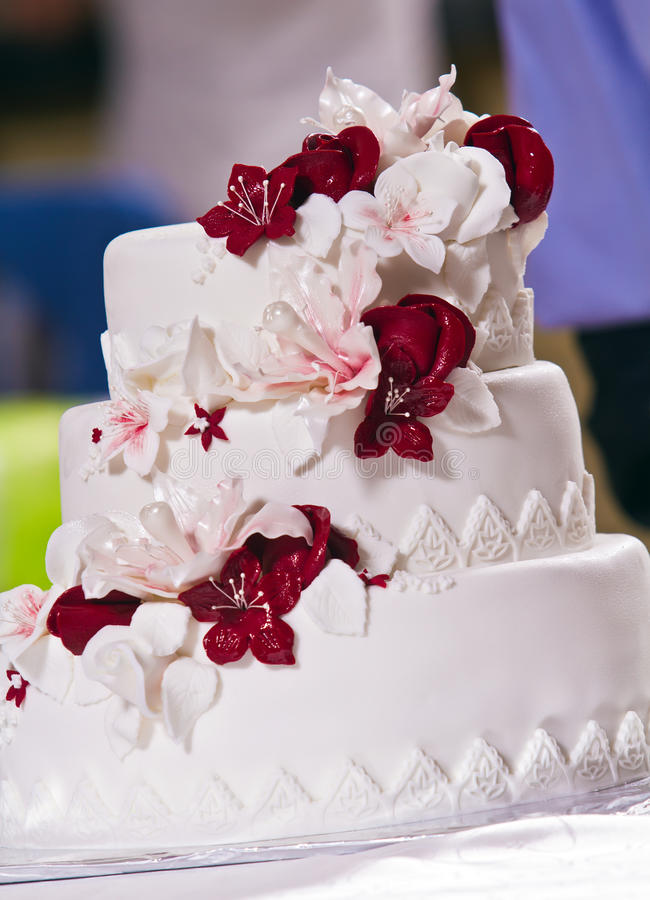 Wedding cake. Marzipan flowers as decoration on wedding cake royalty free stock photography