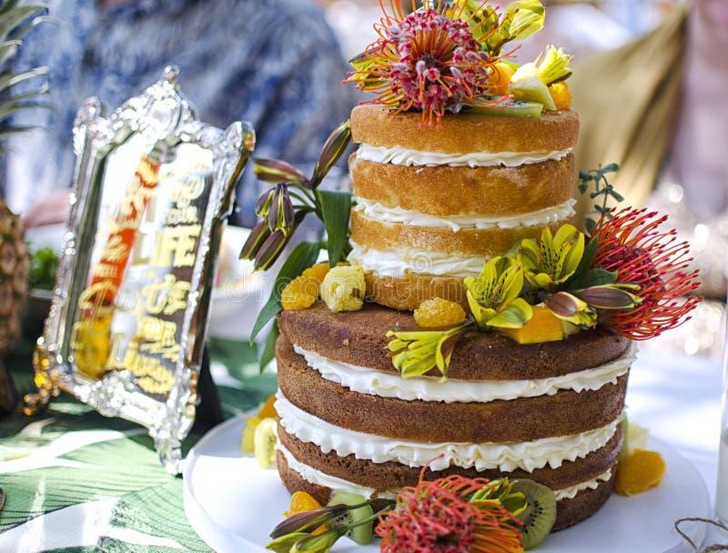 Wedding Cake. 'Naked' Wedding cake - made of Lilikoi Cream and Sponge royalty free stock photography