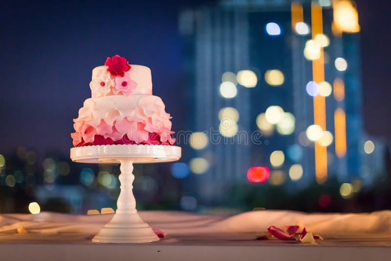 Wedding cake at night. Beautiflu wedding cake at wedding party at night stock image
