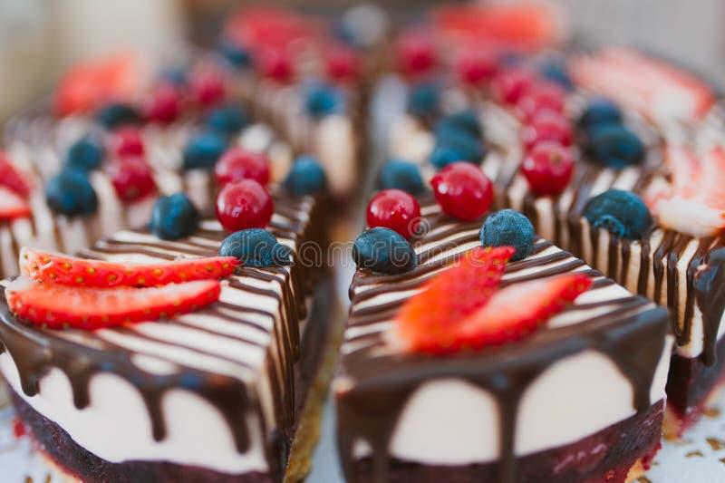 Wedding cake. Piece with berries closeup stock photo