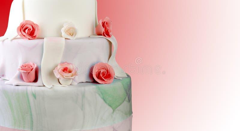 Wedding cake with roses stock photos