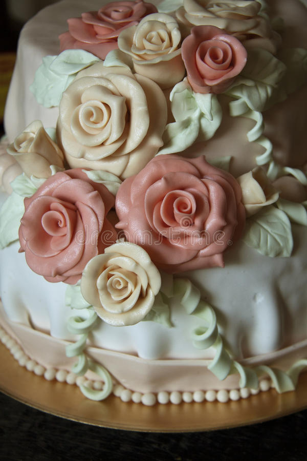Wedding cake with roses. And ribbon royalty free stock images