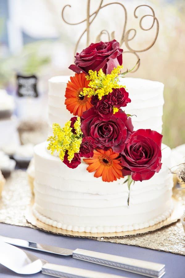 Wedding cake on table at garden wedding royalty free stock photos
