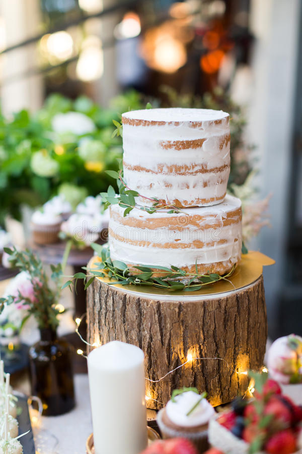 Wedding cake. Tiered wedding cakes at outdoor wedding party royalty free stock image