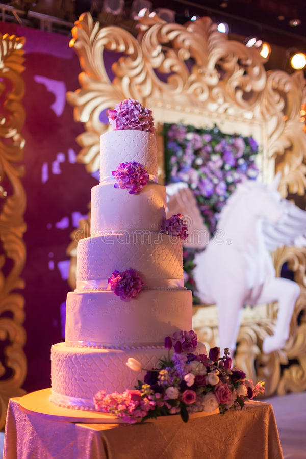 Wedding cake. Tiered wedding cakes at outdoor wedding party stock photos