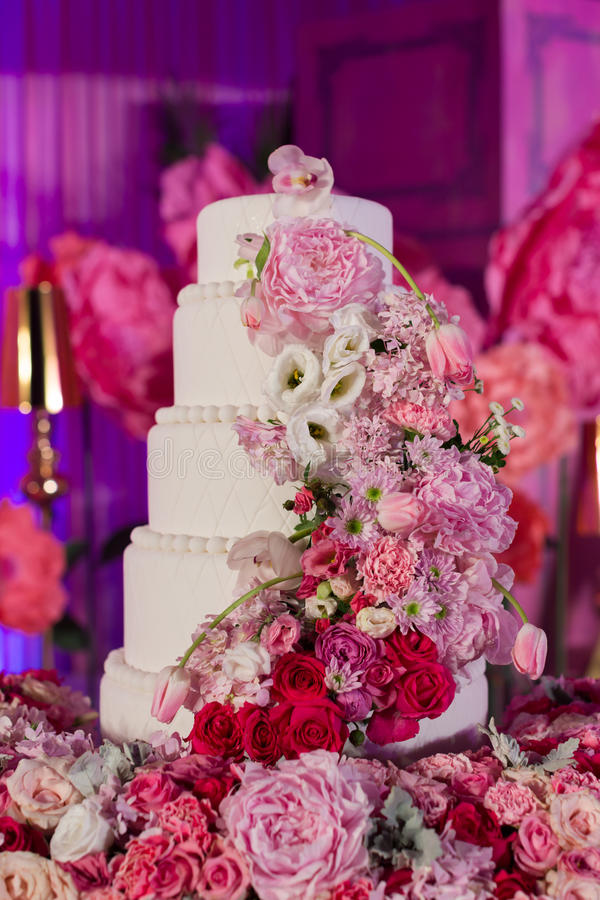 Wedding cake. Tiered wedding cake at indoor wedding party royalty free stock photography