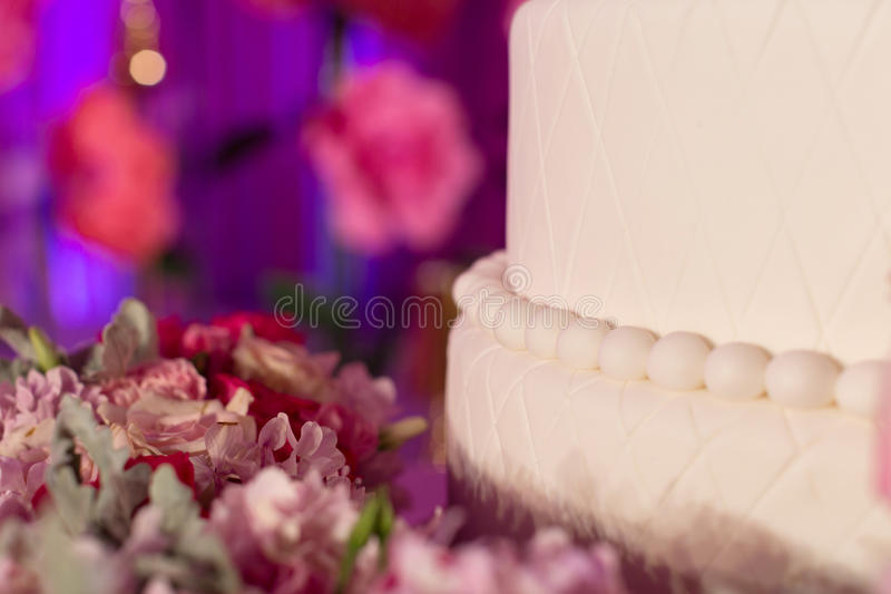 Wedding cake. Tiered wedding cake at indoor wedding party stock photo