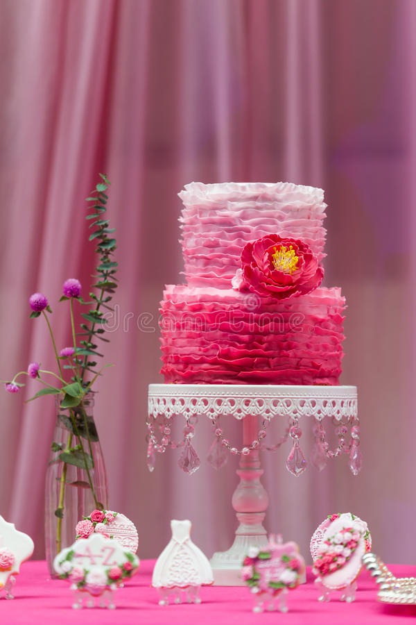 Wedding cake. Tiered wedding cake at indoor wedding party stock photos